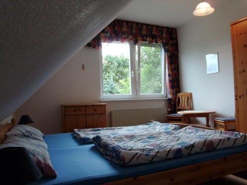 Schlafzimmer mit Doppelbett - Ferienwohnung, Brandenburg